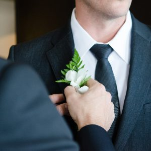 White floral buttonholes for all of the groomsmen